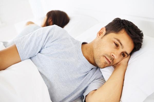 worried-man-in-bed